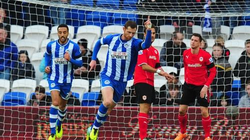 Wigan's Chris McCann (centre) celebrates after scoring the opening goal
