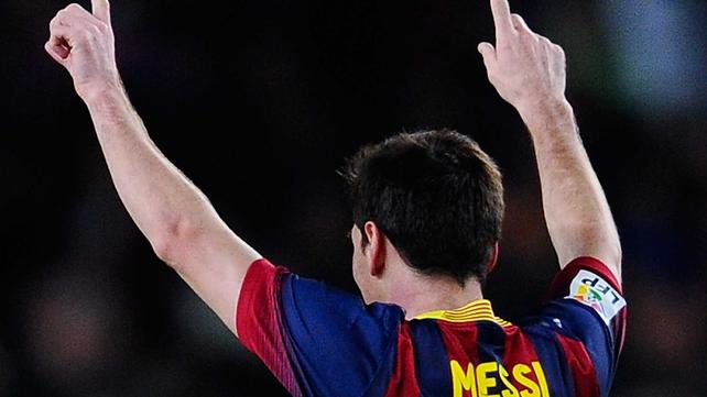 Lionel Messi celebrates scoring against Rayo