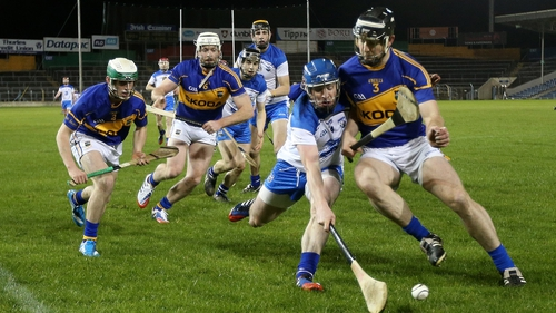 Tipperary's Conor O'Mahony and Shane Walsh of Waterford compete for the ball
