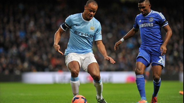 Manchester City's Vincent Kompany competes with Chelsea's Samuel Eto'o