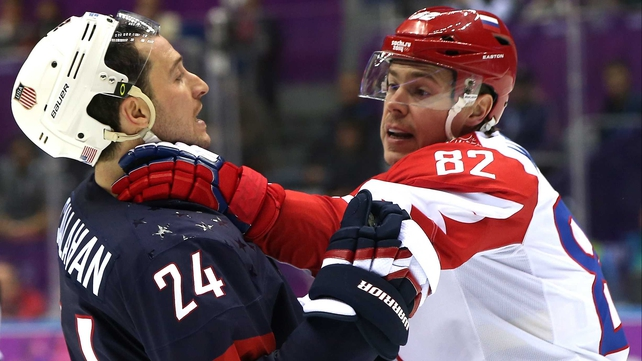 Evgeny Medvedev of Russia faces off with USA's Ryan Callahan