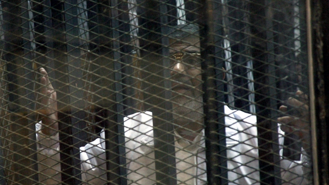 Mr Mursi's legal team protested they could not hear their client speak from inside a soundproof glass cage