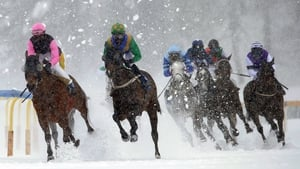 Eduardo Pedroza (L) on Zarras is on his way to win the Grand Prix Prestige on the frozen lake on the second weekend of the White Turf races in St Moritz in Switzerland.