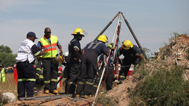 After being medically assessed the miners have been handed over to police (pic credit: EPA)