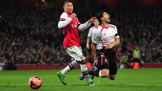 Liverpool's Luiz Suarez was denied what appeared a certain penalty