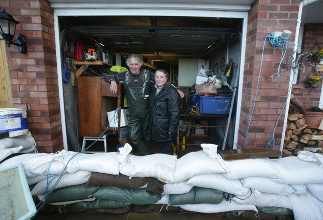 Homeowners use sandbags to protect their homes in Moorland, Somerset