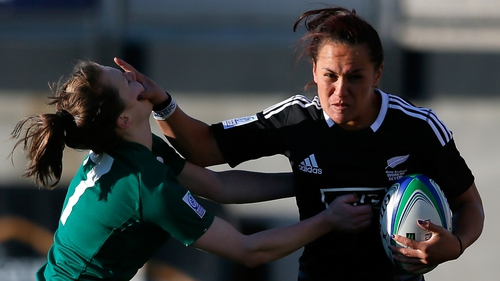 New Zealand player stiff arms Aoife Doyle of Ireland during the IRB Women's Sevens World Series in  Georgia