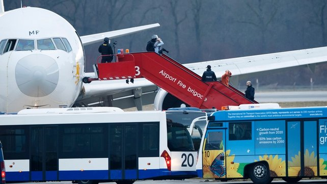 Passengers are evacuated from the plane (Pic: EPA)