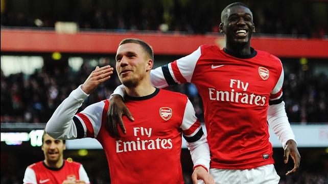 Lukas Podolski (L) scored Arsenal's winner against Liverpool