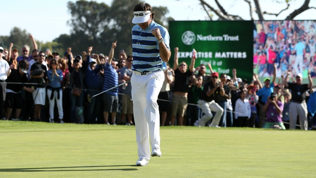 Bubba Watson celebrates his birdie putt on the 18th green to win the Northern Trust Open