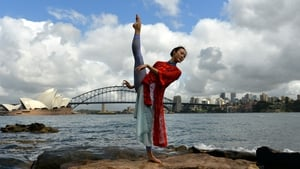 Performer Zhang Yashu from a Chinese ballet company performs during a photo shoot in front of Sydney's Opera House and Harbour Bridge