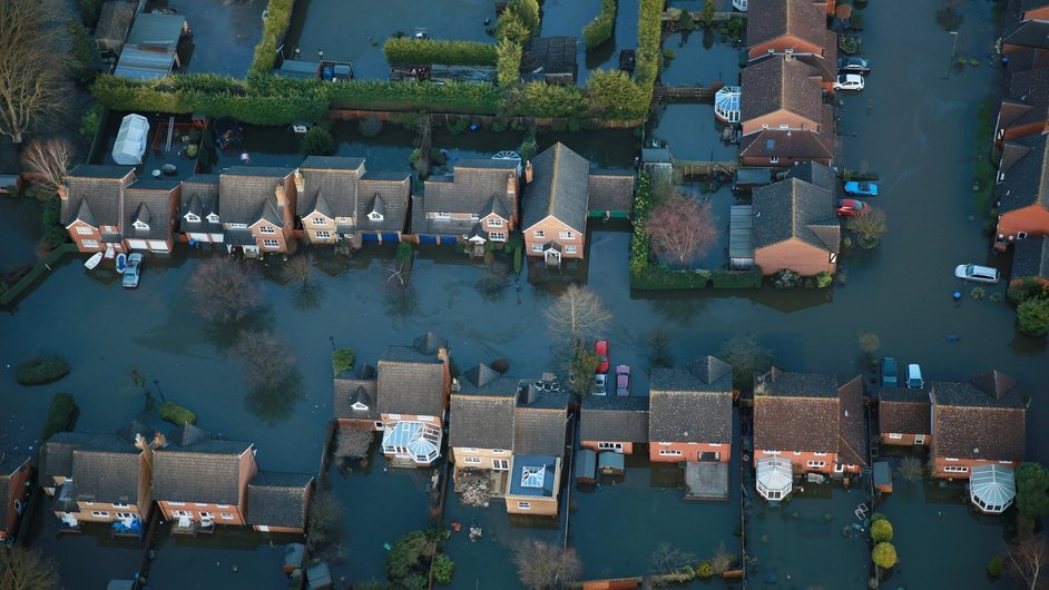 Houses in Blackett Close are inundated with flood water in Staines-Upon-Thames, England