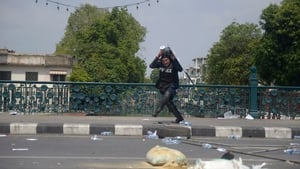 A police officer runs after getting injured