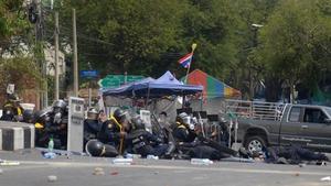 Several officers were injured in suspected grenade blasts