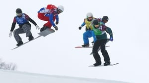 Competitors in the snowbarding racing event at the Winter Olympics in Sochi get some hang time