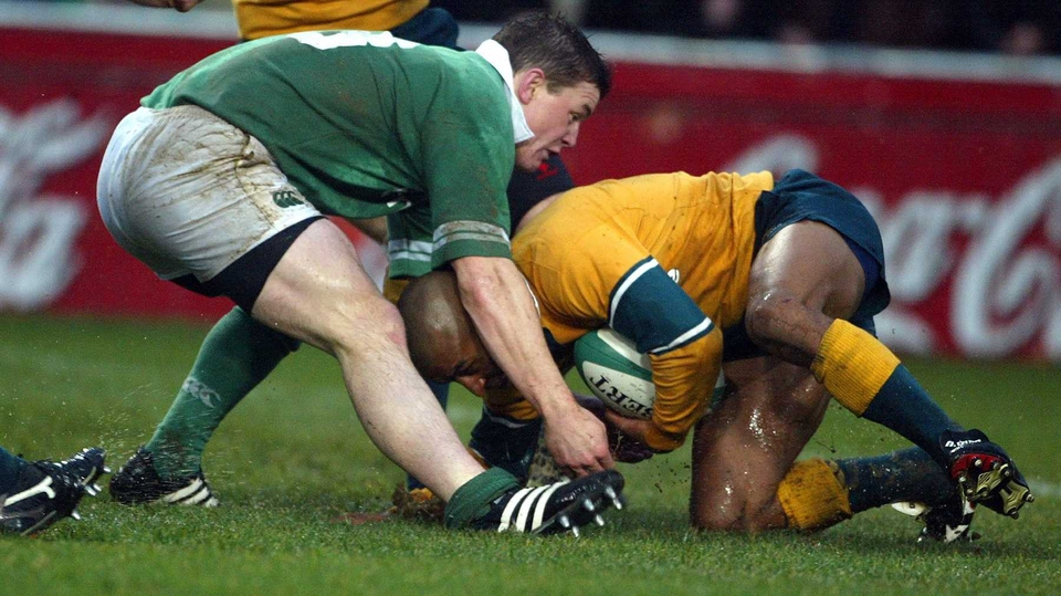 Brian O'Driscoll gets to grips with another stalwart, Australia's George Gregan, during a clash in 2002