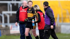 Colm Cooper leaving the field after damaging his cruciate