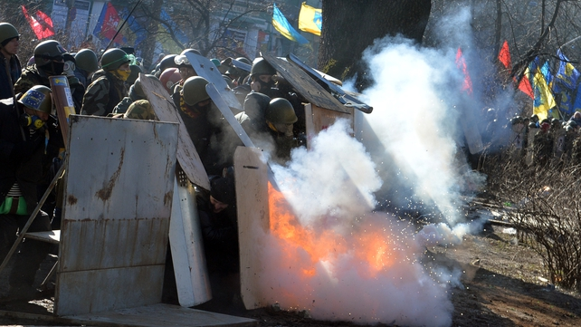 Protesters and police clash in Kiev