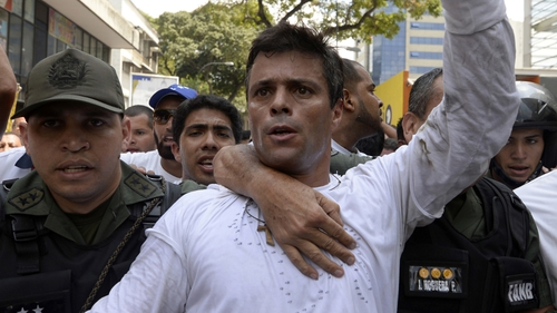 Leopoldo Lopez handed himself into the authorities