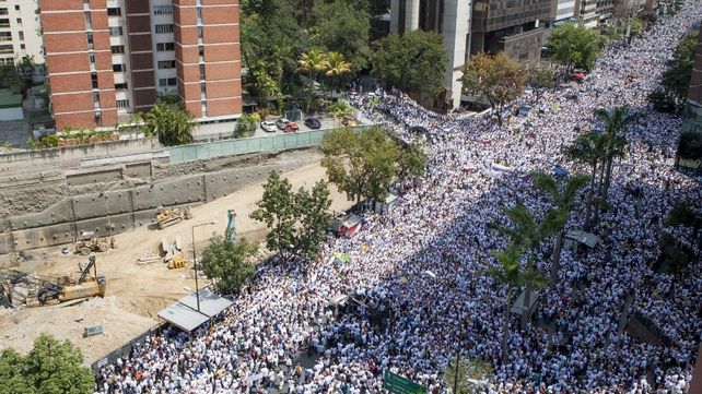 Thousands took part in a protest before Mr Lopez was taken into custody by the Venezuelan National Guard (Pic: EPA)