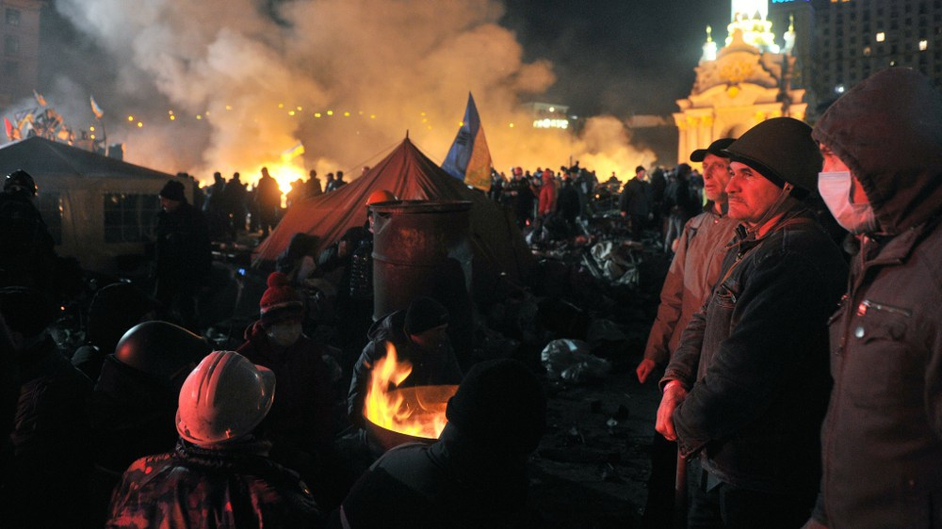 Flames engulfed the main anti-government protest camp on Independence Square