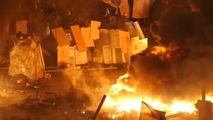 Protesters protect themselves with shields against advancing riot police forces moving on Independence Square (Pic: EPA)