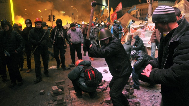 Protesters dig up paving stones to use as missiles
