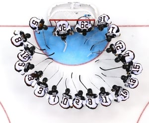 The Japanese ice hockey team huddles at the Sochi Games