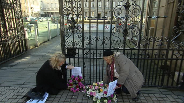 Wreaths were laid at the gates of Leinster House on the anniversary of the Taoiseach's apology
