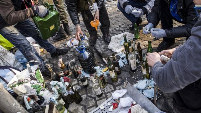 Protesters prepare petrol bombs