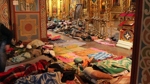 Wounded protesters lie on the floor of St Michael's