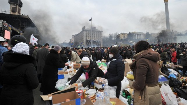 Volunteers hand out food and drink to protesters in Independence Square