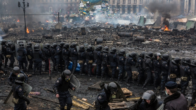 Riot police form a barrier in Independence Square