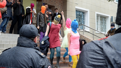 Pussy Riot members leave a police station near Sochi after being questioned about an alleged theft