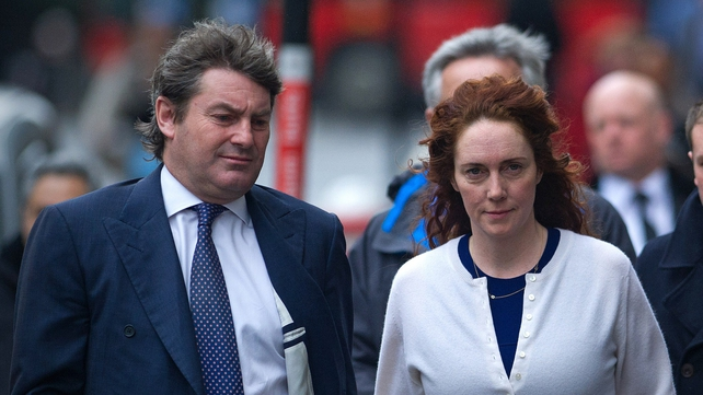 Rebekah Brooks (R), former News International chief executive, and her husband Charlie arrive for the phone-hacking trial at the Old Bailey