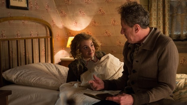 Sophie Nélisse and Geoffrey Rush play Liesel and her foster father Hans