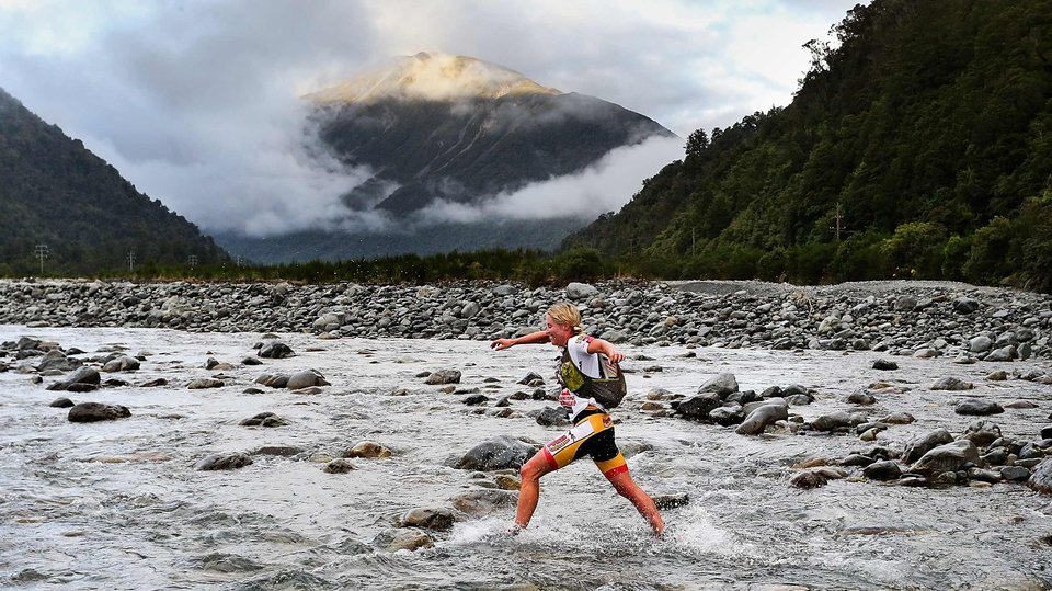 A competitor gets her feet wet during the one-day individual event at the Speights Coast to Coast in Christchurch, New Zealand