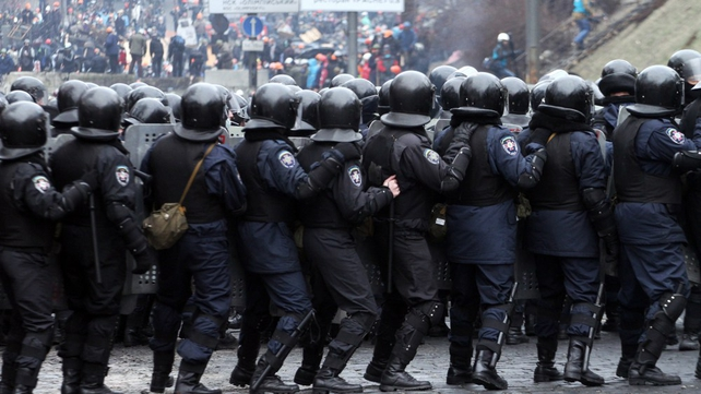 Riot police face protesters during fierce clashes central Kiev