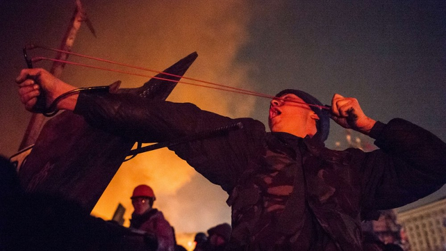 Clashes continue as night falls in Kiev