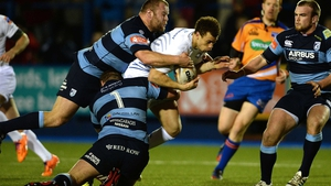 Zane Kirchner is brought to ground by two Blues tacklers