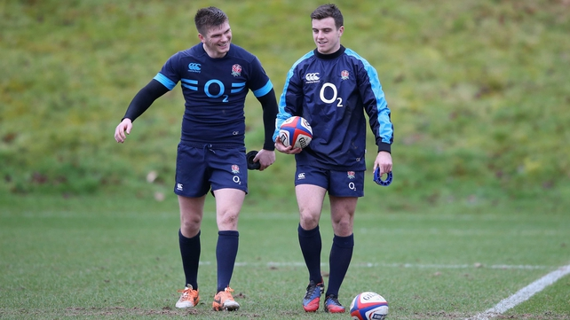 George Ford (r) talks to team-mate Owen Farrell during England training at Pennyhill Park