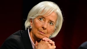 IMF chief Christine Lagarde says that forceful headwinds are threatening the global economy