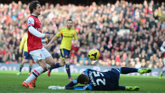 Tomas Rosicky lifts the ball over lifts the ball over Vito Mannone for Arsenal's third goal