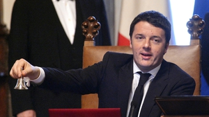 Newly-appointed Italian Prime Minister Matteo Renzi rings a silver bell, marking the start of his office, before the start of his first cabinet meeting at Rome's Chigi palace