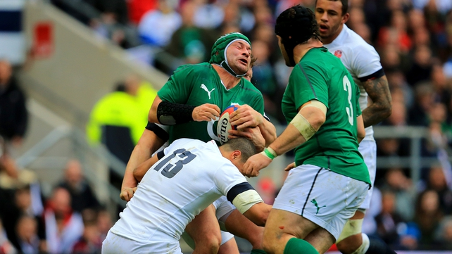 Rory Best is tackled against England
