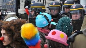 Protesters face French riot police  in Nantes, during a demonstration against the project to build an international airport in the French western city of Notre-Dame-des-Landes. The disputed project was signed in 2010