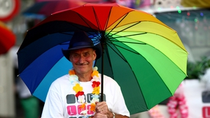 Participants take part in the Auckland Pride Parade along Ponsonby Road in Auckland, New Zealand