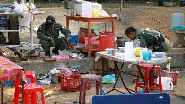 Members of a bomb squad unit inspect the site of an attack near an anti-government rally in Trat province
