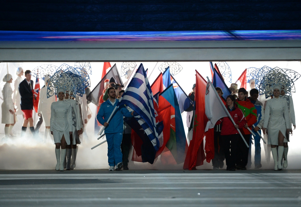 Flag-bearers enter stadium as the ceremony begins