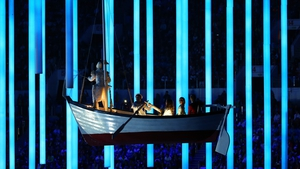 A boat floats serenely across the stadium during the closing ceremony